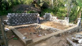 construction of two rooms of a house for a poor family in Sri Lanka